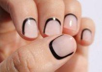 unghie corte con smalto rosa e nero